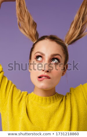 Image of thinking pretty woman having fun with two tails Stock photo © deandrobot