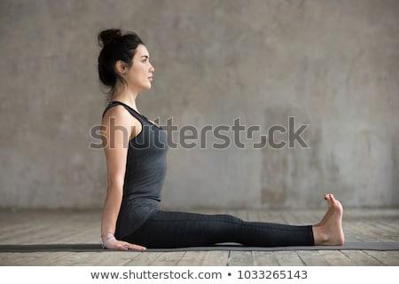 Woman Practicing Staff Pose Yoga Asana Stock photo © rognar