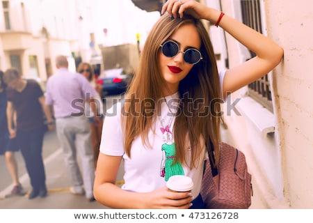 portret · wesoły · młoda · dziewczyna · kręcone · włosy · telefonu · komórkowego - zdjęcia stock © hasloo