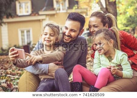 Cheerful family of five taking self portrait Stock photo © get4net