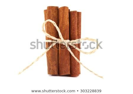 Cinnamon Sticks Tied Over White Stock fotó © Francesco83