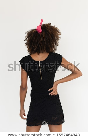 pretty young woman untangling her hair stock photo © photography33