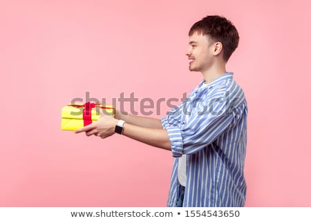 side view of smiling young man stock photo © stockyimages