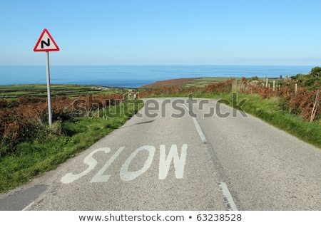 Slow sign on an English countryside road. Stock photo © latent