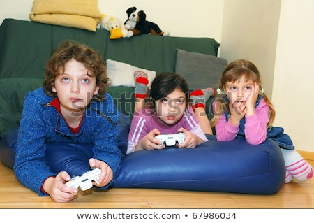 Brother and sister with hand-held video games Stock photo © photography33