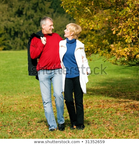 Mature couple out for an autumn stroll Stock photo © photography33
