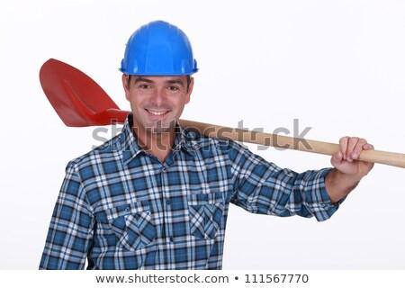 Builder stood resting shovel over shoulder Stock photo © photography33