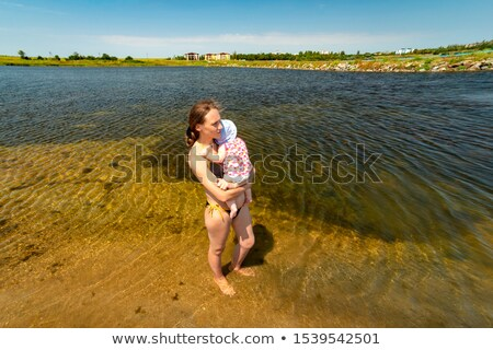 two playing beautiful girls on the background of the river 1 stock photo © acidgrey