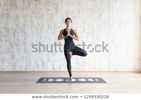 young brunette standing on one leg stock photo © acidgrey