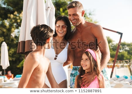 女性の笑顔 少年 デッキチェア 女性 家族 笑みを浮かべて ストックフォト © photography33