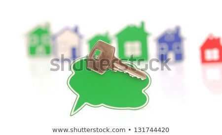 bubble speech and silver key over the houses background  Stock photo © inxti