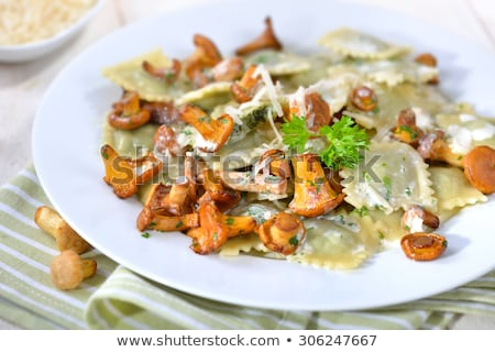 roasted chanterelles with cheese sauce stock photo © zhekos