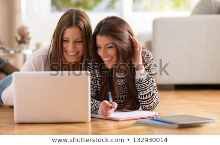 Stok fotoğraf: Two Young Womans Lay Together