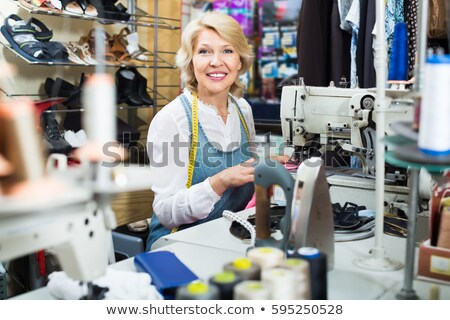 Portrait of a smiling middle age woman stitching  Stock photo © dashapetrenko