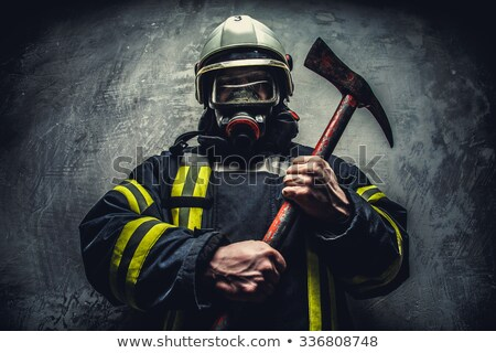 man with axe and protective gear Stock photo © pxhidalgo
