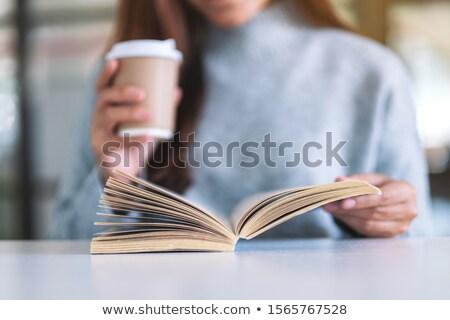 Kız okuma kitap oturma tablo beyaz Stok fotoğraf © fotoatelie