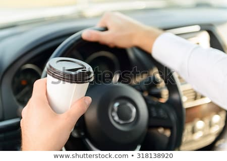 man drinking coffee while driving the car stock photo © dolgachov