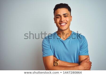fashion man wearing blue shirt posing for the camera stock photo © feedough