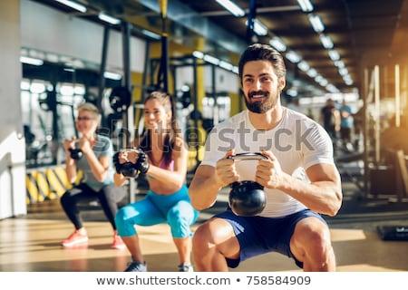 woman man gym group weightlifting workout Stock photo © lunamarina