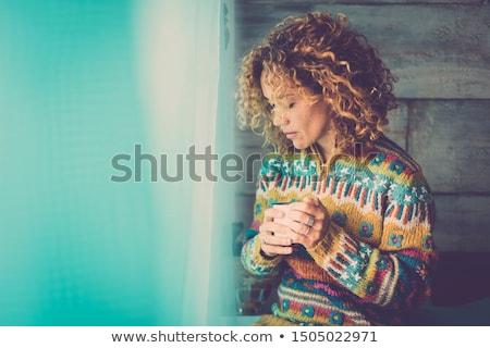 Pretty thoughtful woman Stock photo © acidgrey