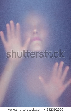 Blonde woman touching frosted glass Stock photo © wavebreak_media