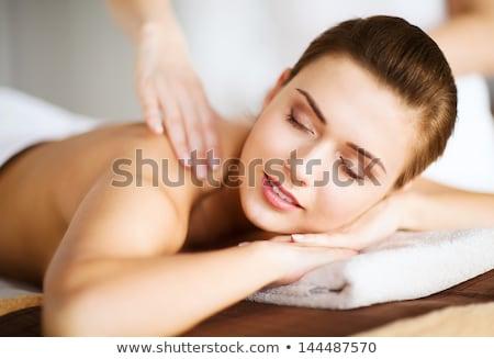 Beautiful blonde woman gets spa treatment in salon Stock photo © dashapetrenko
