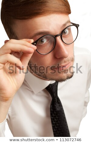 Portrait of curious bearded young businessman in glasses Stock photo © deandrobot