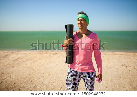 Funny Girl Meditating on Yoga Mat in Nature Stock photo © NicoletaIonescu