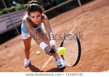 Girl with tennis racket on sunny day Stock photo © wavebreak_media