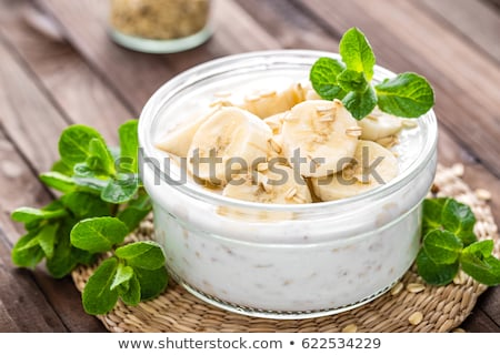Fresh banana yogurt with oats, delicious dessert for healthy breakfast Stock photo © yelenayemchuk