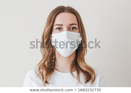 Portrait of a beautiful girl with white mask stock photo © zurijeta