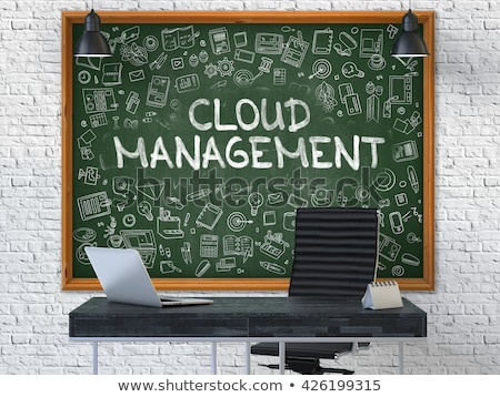 Chalkboard on the Office Wall with Cloud Management Concept. Stock photo © tashatuvango
