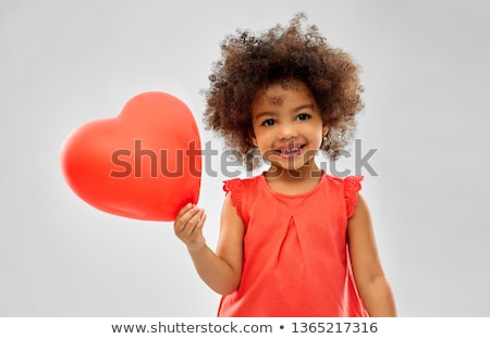 lovely afro girl with red balloons stock photo © neonshot