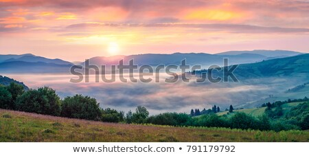 Beautiful sunrise in mountain village Stock photo © Kotenko