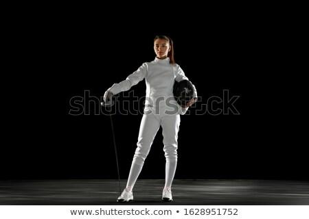 Stock photo: Female fencer