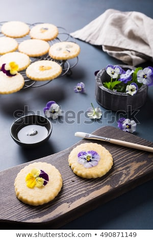 Homemade shortbread cookies with edible flowers Stock photo © Melnyk