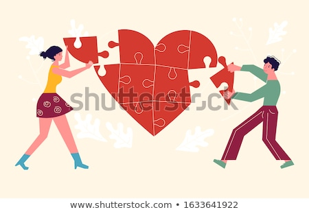 man connecting broken heart with jigsaw puzzle stock photo © andreypopov