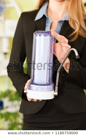Welldressed woman holding modern faucet container Stock photo © Kzenon