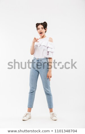 Full length portrait of excited european woman having double bun Stock photo © deandrobot