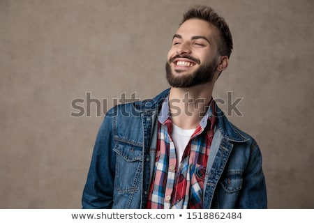 relaxed casual man wearing shirt with checkers looks to side Stock photo © feedough