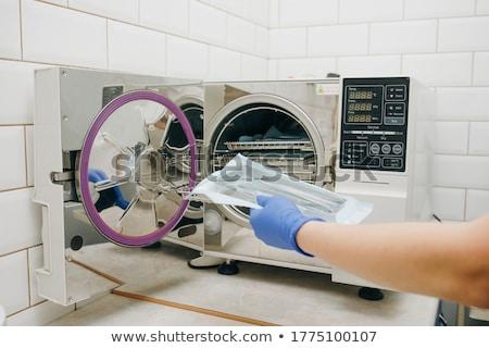 dentista · herramientas · dentales · clínica · odontología · medicina - foto stock © dolgachov