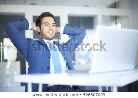Portre gülen genç işadamı oturma ofis Stok fotoğraf © Minervastock