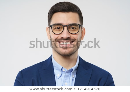 portrait of relaxed young businessman wearing blue suit Stock photo © feedough