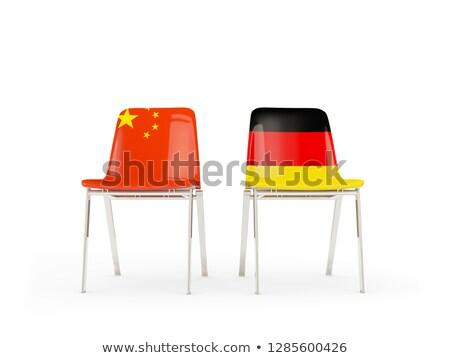 Dwa krzesła flagi Chiny Niemcy odizolowany Zdjęcia stock © MikhailMishchenko