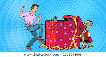 Man and dog puppy as a gift holiday box, funny reaction joy Stock photo © studiostoks