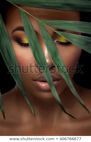 Portrait of a beautiful lady with jungle in the background Stock photo © majdansky