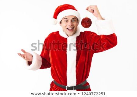 Image of european man 30s in santa claus costume and red hat hol Stock photo © deandrobot