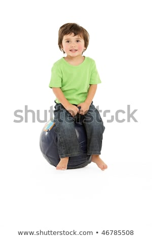 young boy having fun on inflatable hopper stock photo © monkey_business