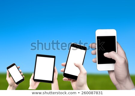 hand holding a touchpad pc with green field  Stock photo © Suriyaphoto