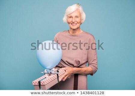 Happy elegant mature woman with balloon and giftbox Stock photo © pressmaster